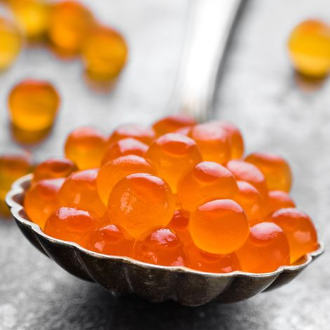 Close-up of orange roe lying in a spoon